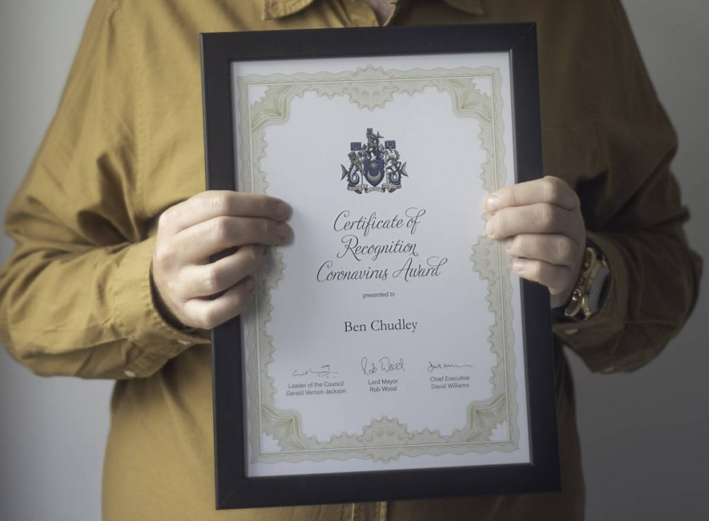 Ben Chudley holding Lord Mayor Awards Nightingales Golden Care for Outstanding Service Mayors